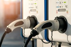 Free Electric Car Charging Station. Plug For Vehicle With Electric Motor. Coin-operated Charging Station. Clean Energy Power. Royalty Free Stock Photography - 122657957