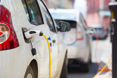 Electric Car in Charging Station. Stock Images