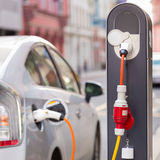 Electric Car in Charging Station. Royalty Free Stock Images