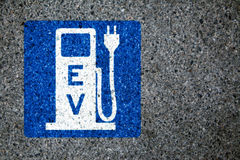 Electric car charging station. Sign on the asphalt Stock Image