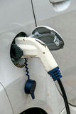 Electric car charging station to Royalty Free Stock Photos