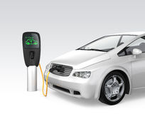 Electric car at charging station Stock Photo