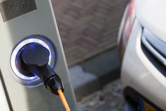 Electric car charging Royalty Free Stock Image