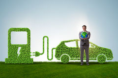 The electric car concept in green environment concept. Electric car concept in green environment concept stock photos
