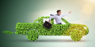The electric car concept in green environment concept. Electric car concept in green environment concept stock images
