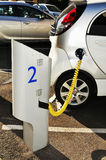 Electric car. Detail of electrical car in charging position connected to an electric power source Stock Images