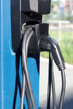 Electric car energy station charger pump power recharge electrical vehicle cables Royalty Free Stock Image