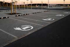 Electric car free charge - Empty parking lots during Golden Hour sunset at a popular typical Shopping centre royalty free stock image