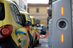 The electric car in Free Recharging Station. FLORENCE, ITALY - MARCH 27: The electric car in Free Recharging Station in Florence historical center in march 27 Stock Photos
