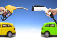 Electric car and gasoline car concept Stock Photography