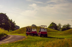 Electric car on the golf course, active leisure, quiet sport, re Royalty Free Stock Images