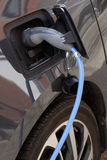 Electric car loading. Plug an electric car at a charging point stock image
