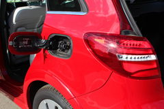Electric car. Red color. Mercedes B-Class Electric Drive. Electric car charging at charge point Royalty Free Stock Photos
