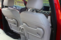 Electric car. Red color. Mercedes B-Class Electric Drive. Electric car charging at charge point. Cabin interior comfort. Interior of the car Stock Photos