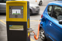 Electric car. Milan ( Italy ) 12/14/2015: The electric car stations start to be diffused in the cities due of the increase market of elecrtic cars favorite of Stock Images