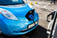 Electric car near the charging station. In the city royalty free stock photo