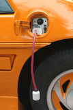Electric car orange royalty free stock image