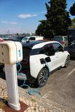 Electric car parked and charging stock photography