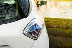 Electric car parked in front of a lake Stock Photography