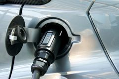 Electric car plug. Detail of an electric car's connected plug Stock Photo