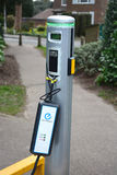 Electric car plug in charging station Stock Images
