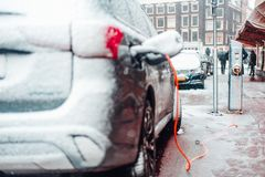Electric car plug charging in the winter. Amsterdam, Netherlands stock photo