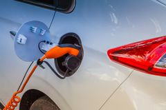 Free Electric Car Plug In Stock Photography - 146281702