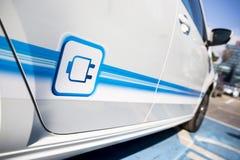 Electric car plug in Stock Photos