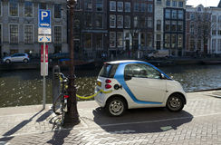 Electric car. Plugged in next to an amsterdam canal Royalty Free Stock Images