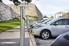 Electric car plugged in to electricity Stock Photography