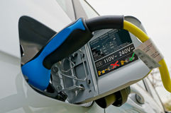 Electric car recharging Royalty Free Stock Image