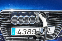 Electric car recharging battery, Barcelona. Barcelona, Spain - June 21, 2016: Electric or hybrid car of the Audi brand recharging the battery in a charging point Royalty Free Stock Photo