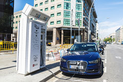 Electric car recharging battery, Barcelona. Barcelona, Spain - June 21, 2016: Electric or hybrid car of the Audi brand recharging the battery in a charging point Stock Photos