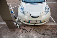 Electric car recharging Stock Photo