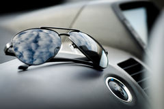 Electric Car start ignition button. Sunglasses near the engine start button hybrid car Stock Image