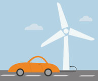 Electric car technology concept with wind turbine Royalty Free Stock Image