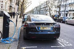 Free Electric Car Tesla Model S Recharging The Batteries Royalty Free Stock Photography - 107385647