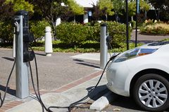Electric car under charging. New energy vehicle, charging pole, recharge Stock Image