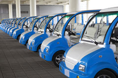 Electric cars. Many electric cars parking in a line and being recharged Stock Image