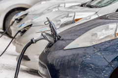 Electric cars charging at recharg. Montreal, CA, 4 February 2017. Electric cars charging at recharging station Stock Image
