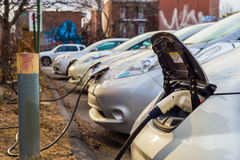 Electric cars charging at recharging station. Montreal, CA, March 21th 2016. Electric cars charging at recharging station Royalty Free Stock Image