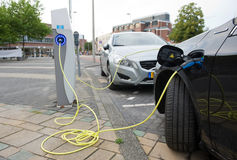 Electric cars at charging station Stock Photos