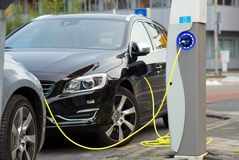 Electric cars at charging station Royalty Free Stock Images
