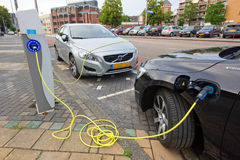 Electric cars at charging station Stock Image