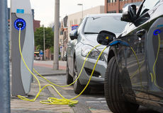 Electric cars at charging station Stock Images