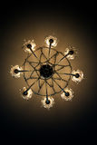 Electric ceiling lamp shines with yellow light. View from below electric ceiling lamp shines with yellow light Royalty Free Stock Photography