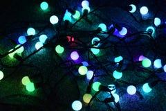 Electric Christmas lights on the floor. stock photos