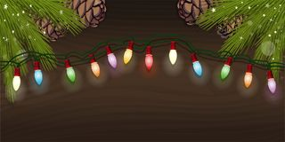 Glowing electric garland for christmas design. Electric Christmas tree garland with multicolored bulbs for christmas design. Glowing electric garland and spruce Stock Image