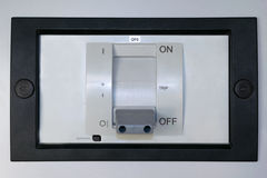 Electric circuit breaker on the front panel of the electrical Cabinet. stock photo