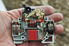 Electric circuit breaker overload burned. Stock Images